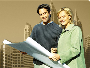 young couple holding a large drawing paper